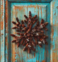 heavy duty cardboard; draw snowflake design; hot glue pine cones;  pine cone wreath
