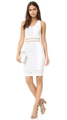 Open-knit bands cut across the waist and hem of this formfitting knit Rebecca Minkoff dress. Double-V neckline and angular racer back. Sleeveless. Unlined.