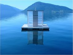 floating sauna in Norway is anchored in the middle of a fjord