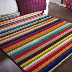 e0ebe47030d9d6 Cascades of vibrant colours leap across each rug in this collection. Hand  carved to enhance