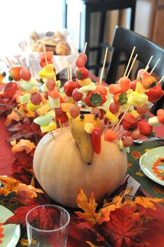 Centerpiece for the kids table for Thanksgiving.  Fruit Kabob Turkey!