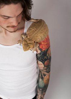 this guy has a bearded dragon.... swoon.