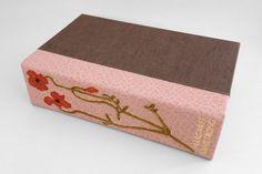 Field Book of Western Wild Flowers illustrations by Margaret Armstrong bound by Erin Fletcher // leather spine clamshell box with embroidered detail on spine. illustrator's name tooled in 23kt. gold leaf on spine.