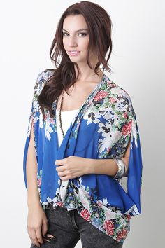 Stay in touch with fall fashion in the Blossom Season Kimono. Featuring floral print throughout, chiffon construction, open front, and asymmetrical hem.