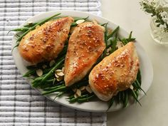 Honey and Sesame-Glazed Chicken Breasts with Green Beans | The paleo diet, also known as the caveman diet, is one based off ancient eating practices. The diet avoids foods that our early, early ancestors wouldn't have been able to cook, like beans and grains, or foods that might have been unavailable, like milk or sugar. These easy dinners follow those guidelines, and feature hearty cuts of meat along with a focus on fresh vegetables and fruit. Everything from salads to soups to skillet…