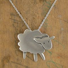 A fluffy cloud of cuteness comes your way when you wear this sheep necklace. It measures one inch tall. Made from sterling silver. - marmar on Etsy