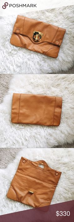 """Chic Camel fold over Clutch ✨ Great condition // fits all your essentials! // gold hardware // no major flaws or damage as shown // twist turn closure // fully lined floral fabric accented interior // goes with everything! // leather refers to leather textured fabric // approx 12.75"""" x 8"""" // camel tan tone is my favorite for this fall season! // dress this up or down as your go-to handbag ✨ Nila Anthony Bags Clutches & Wristlets"""