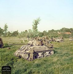 "Sherman Firefly Vc T212680 'Belvedere' of ""B"" Squadron, Staffordshire Yeomanry, 27th Armoured Brigade, along with other armour and infantry prior to the commencement of 'Operation Goodwood' on the morning of 18th July, 1944."