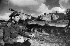 "A Soviet officer (captain of the Red Army) poses next to the destroyed German heavy tank Pz. H ""Tiger I"" No. 308 of the Wehrmacht battalion. Date: April Source: World War 2 album German Soldiers Ww2, German Army, Military Armor, Military Uniforms, Ww2 Photos, Photographs, Tiger Tank, Ww2 Tanks, Red Army"