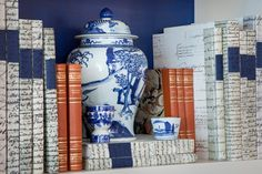 love the books, and vase, orange and blue, marbelized paper