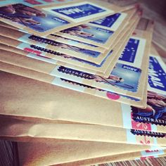 A stack of Christmas mail going to penpals by Bella J Style www.bellajstyle.etsy.com #bellajstyle #penpal #christmasmail #snailmail #sendmoremail #handwrittenletters