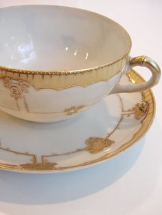 gold and white tea cup
