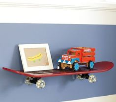 A skateboard shelf... I made one for my son's room from a $9 skateboard (Target) and some L brackets.