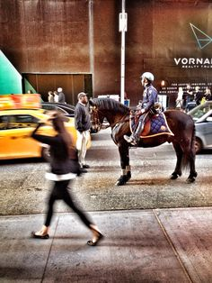 A horse, a policeman, a girl, a man and a taxi.  #onlyinnyc #nyc #taxi #travel