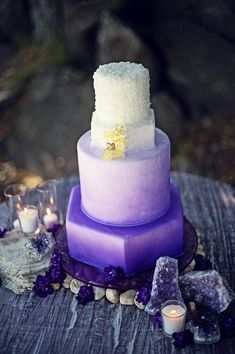 A technique for creating ombre for your wedding cake is an airbrush gradient. This looks especially good for more vibrant colors as it softens up the style a bit without losing any of its statement-making qualities, as seen in this purple ombre wedding cake.