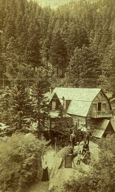 The Cog Railway passed this log-cabin lodge along it's route to the summit of Pike's Peak. It appears that the lodge also offered lunch, coffee and lemonade. Note the menu board sat upon the rock- most likely facing the railway tracks. 1909