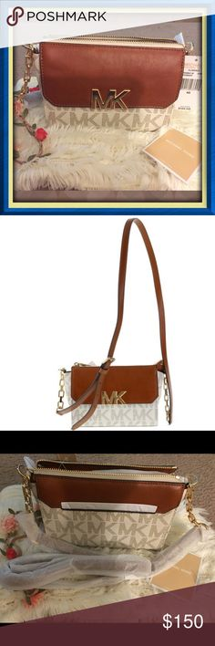 Authentic MK Crossbody Bag Michael Kors crossbody with gold toned hardware Top zip closure; Front pocket with flap and snap closure Back slip pocket; Adjustable chain and leather strap with a maximum drop of approx. 25 inches Interior features 1 zip pocket and 3 card slots Approx. dimensions: 7.5 in L x 5 in H x 2.75 in W.Very beautiful so love ittrade lowballs Michael Kors Bags Crossbody Bags
