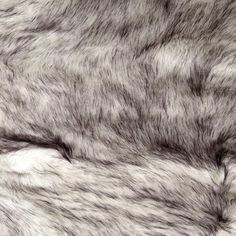 Faux Fur Husky Black/White from @fabricdotcom  Spoil yourself with this exquisite long hair faux fabric. Fur has 2'' pile, a luxurious hand and a soft subtle sheen just like the real thing! Make gorgeous jackets, coats, wraps, fashion accessories, pillows, throws and more!