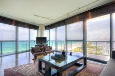 Step inside this gorgeous oceanfront condo in Miami (via JustLuxe).    Are you an oceanfront kind of person or do you prefer the city?