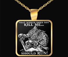 """That Which Does Not Kill Me... Should Run!""      22 inch necklace chain that fits great on anyone.    Note: the core metal of the necklace is zinc alloy that is then wrapped in a gold plating. Since the core of the pendant is zinc alloy it doesn't have a karat rating. The gold plating is 0.2 millimeters thick to ensure a beautiful, lustrous, shine.    A custom hardened resin insert is placed on top of the pendant to give it the highest quality color vibrance possible. 