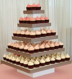 Cupcake tower display with the cupcake frosting going lighter towards the bottom #wedding #cupcake #weddingcupcakes #cupcaketower #dessert