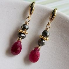 """Tiny drop earrings featuring faceted ruby briolettes, faceted golden pyrite rondelles and goldfilled daisy accents. Finished with vermeil earwires.  Earrings measure a delicate 0.6"""" inches long (just"""