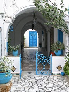 Love the turquoise in this space... love the arches and gate.