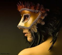 Might have to get some feathers to create this look. Mask-feather headdress.
