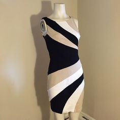 White House black market flattering stripes dress White House black market. Flattering stripes that accentuate the small waist. Tan, black, white. I apologize for the wrinkles! Perfect for any formal or semi formal occasion day or night. White House Black Market Dresses Mini