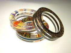 """""""Inclusions"""" Plexiglas bracelets, various fabrics. (2005)"""