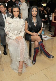 Kim Kardashian Platform Sandals - Kim Kardashian contrasted her frilly dress with simple nude platform sandals when she attended the Fashion Los Angeles Awards.