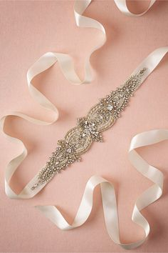 Golden Garden Sash - $425.00 For the bride in search of sparkle, an opulent array of densely beaded crystals centers this luxe gilt sash, which was handmade in Amanda Judge's LA studio.