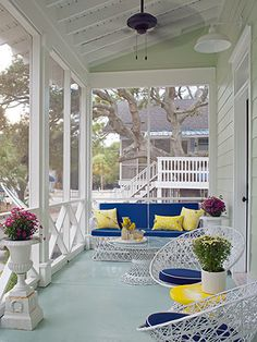 Small #screenedporch shows that cottage style can live large! #goodhousekeeping