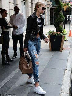 Gigi Hadid.. Retro Super Future Francis Sunglasses, Blue Life Crop Top, Goldsign the Stevie Jeans, and Adidas Originals Superstar Sneakers..