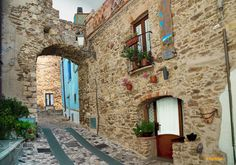 Posada: The Old Village - A passage through the streets of the ancient town of Posada in the province of Nuoro, Sardinia, Italy