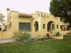 Color detailing on trim and architectural features is a must for this Spanish Bungalow.