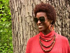 Fall poncho by @INDIGENOUS. F.S.C. certified wood lenses by iwood. Fair trade necklace, World Finds. Afro by nature.