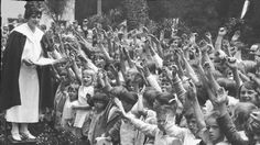 Aimee Semple McPherson Evangelist Aimee Semple McPherson addressing a throng of children in front of her home adjoining Angelus Temple, 1926. (Los Angeles Times)