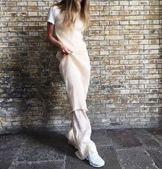 @emilisindlev in her neutrals. We love how unique this outfit is. Check out her page for outfit details!