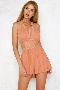 The Valley Of Love Playsuit has a cute v-neckline complimented by tassel trim ties at the back of the neck. The low back and waist is finished with floral lace and there is an invisible zip through the back. Finish the look with a hint of dark bronzer!  Peach playsuit. Not lined. Cold hand wash only. Model is a standard S and is wearing S. True to size. Non stretchy fabric. Polyester.