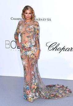 627534af6c9 Paris Hilton and Heidi Klum stole the show in sheer gowns at the 2018 amfAR  Gala at Cannes