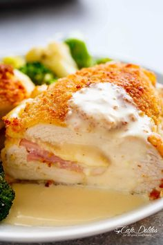 Easy Sheet Pan Chicken Cordon Bleu is a complete dinner for the entire family! Crispy crumbed chicken breasts filled with Dijon mustard, Swiss cheese and ham, baked with vegetables and served with an incredible Dijon Cream Sauce for the ultimate restaurant feel right at home!
