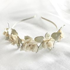 This Emelia Headpiece is a stunning white-on-white flower crown that will withstand the test of time. Each lifelike flower is handmade by Nikki,. White Flower Crown, White Flowers, Wreaths, Headpieces, Handmade, Jewelry, Decor, Hand Made, Decoration