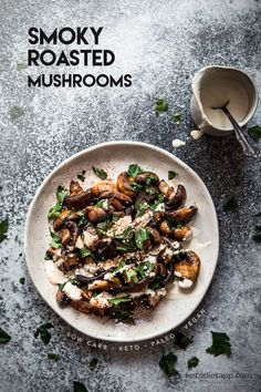 Low-Carb Smoky Roasted Mushrooms - white mushrooms, olive oil (would reduce), smoked paprika, sea salt, fresh parsley, sesame seeds, dressing (tahini sesame paste, water, sea salt, garlic powder, fresh lemon juice)