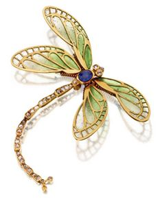 An Art Nouveau dragonfly brooch, circa 1900. The dragonfly mounted en tremblant, the wings of green plique-à-jour enamel, the body set with an oval sapphire and rose-cut diamonds, mounted in gold, Russian assay marks for St. Petersburg. #ArtNouveau #Russian #brooch