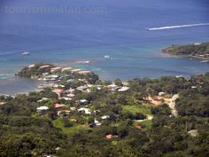 Half Moon Bay in West End & road leading to West Bay Beach. More on the two communities http://tourismroatan.com/things-to-do/must-see-places