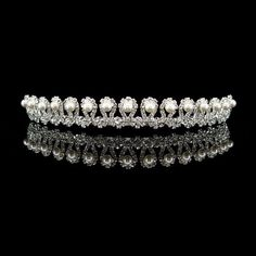 faux pearl and Austrian crystal.  see our facebook page floweringdreams for more details.come like us and keep up to date with new items added