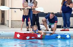 Zachary Odom, takes a seat inside a cardboard boat at the cardboard boat race, held at Aviano Air Base in Italy, Sept. Photo by Norman Llamas/Stars and Stripes Cardboard Boat Race, Military Families, Community Building, Outdoor Recreation, Llamas, Norman, Air Force, Red And White, Stripes