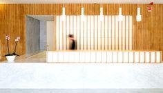 Minho Hotel Renovation   Public Area and Spa wood create warm contrast white walls