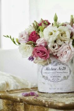 pink white flowers roses in shabby french bucket